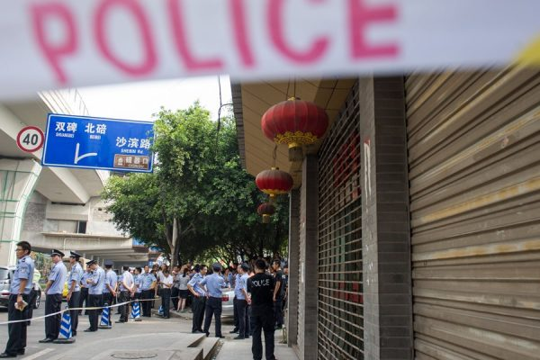 Police cordoned off the scene where Chinese serial robber and murderer Zhou Kehua was shot to death by Chongqing police.