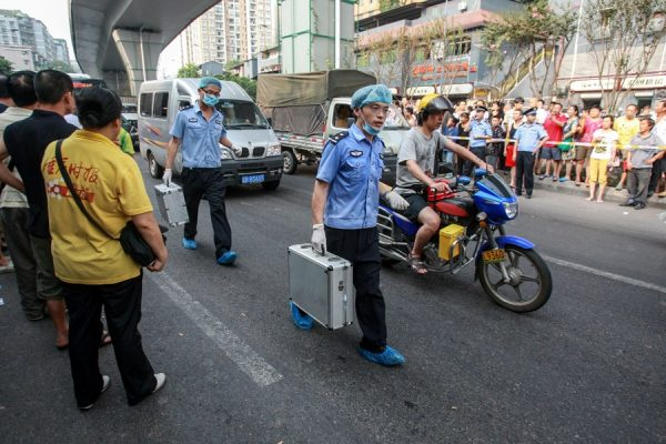 Chongqing police crime scene investigators at the scene where Chinese serial robber and murderer Zhou Kehua was cornered and shot dead by police.