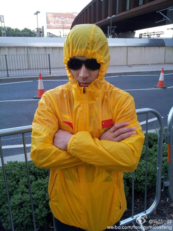 Feng Zhe in a rain jacket, arms crossed.