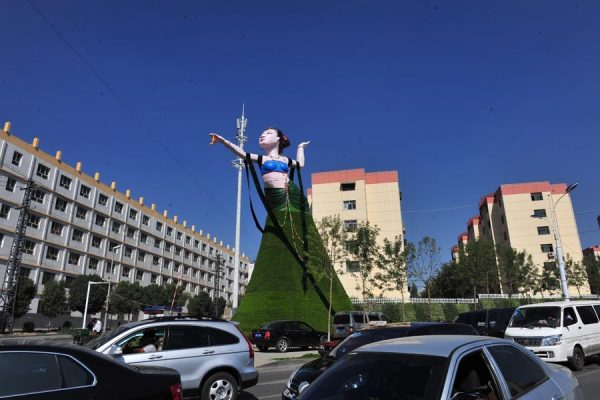 "A ""Flying Apsara"" sculpture in Urumqi, China mocked as ugly by Chinese netizens."