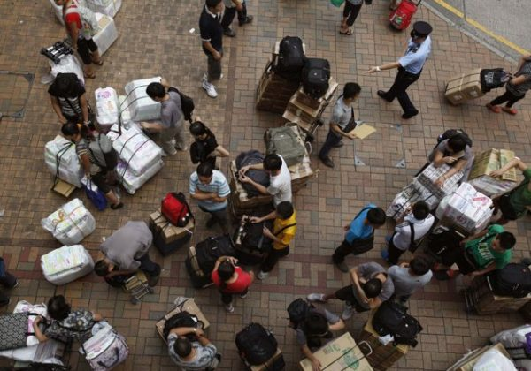 Passengers with boxes of goods clogging the Sheung Shui Rail station in Hong Kong.