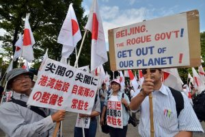 Japanese protesters carrying signs.