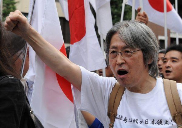 """Senkaku Islands is Japanese territory."" is written on a protester's T-shirt."