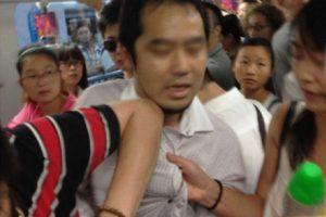 A Japanese Man Caught Taking Photos Underneath Girl's Skirt In Shanghai Metro Line 2