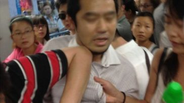 A Japanese Man Caught Taking Photos Underneath Girl's Skirt In Shanghai Metro Line 2