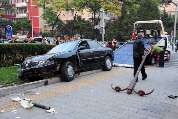 A black Buick on the roadside after being carjacked by a drunk Russian armed with two knives in Beijing.