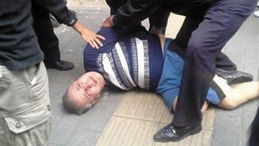 A Russian man being arrested in Beijing by Chinese police after stealing a car, hitting 4 other cars, and 1 person.