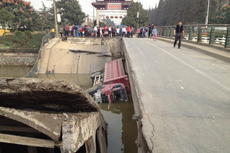 The collapsed bridge and the lorry.