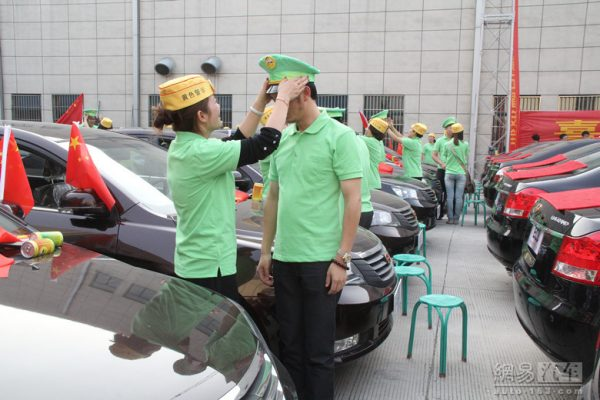 Wives wear green hats on their husbands.