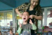 Chinese kindergarten teacher Yan Yanhong in a photo showing her lifting a little boy off the ground by his ears, a photo that eventually got her fired when Chinese netizens discovered it.
