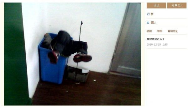 A child is tossed into the trash can.