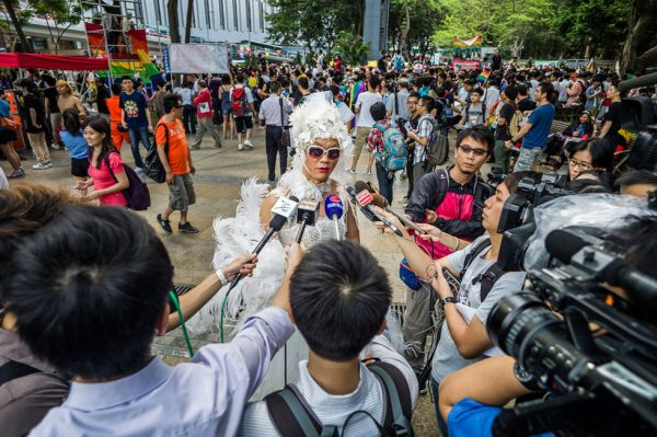 A homosexual parade participant interviews with the media.