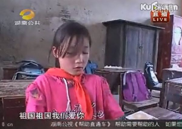 "A young Chinese schoolgirl from an impoverished area of Hunan province is interviewed on television saying she sings a patriotic song ""Motherland, motherland, we love you"" whenever she's hungry because she doesn't have lunch to eat."