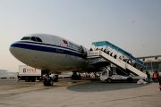 An Air China at the Beijing Airport boarding passengers away from the terminal.