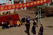 8th grade students at Anhui province's Fuyang Jingjiu Experimental Middle School on their knees, allegedly because they were punished by a teacher, but claimed by the school to have been voluntary as a gesture of contrition begging teachers for forgiveness after being involved in a fight bullying a younger student.