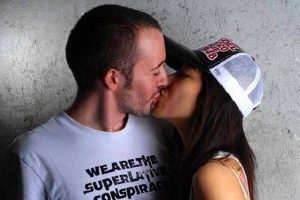"A Chinese girl kissing her Western ""white"" boyfriend."