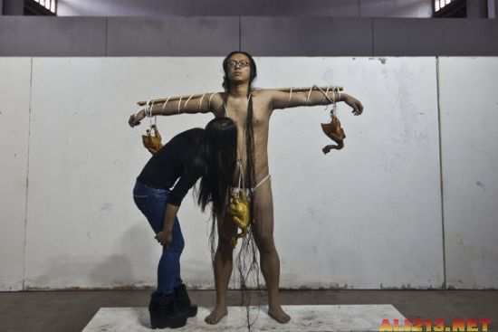Chinese performance artist Kang Yi criticizing attitudes toward love in modern Chinese society.