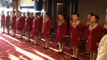Chinese waitresses at Dandong Arirang Restuarant in Liaoning province line up for a group activity..