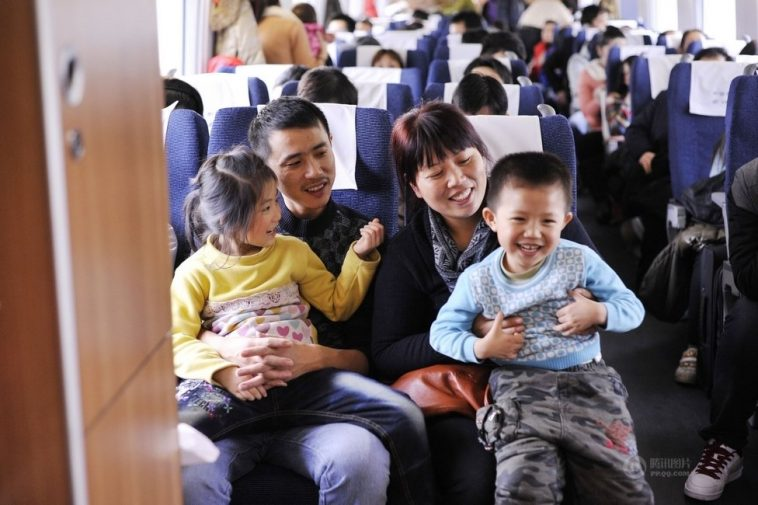 The family is talking happily on the train.