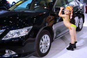Little girls wearing bikinis participating in a modeling competition at a Wuhan auto show in November 2012.