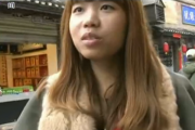"A young Chinese woman interviewed by CCTV News on the street about what he ""lacks"" replies with ""money and a man""."