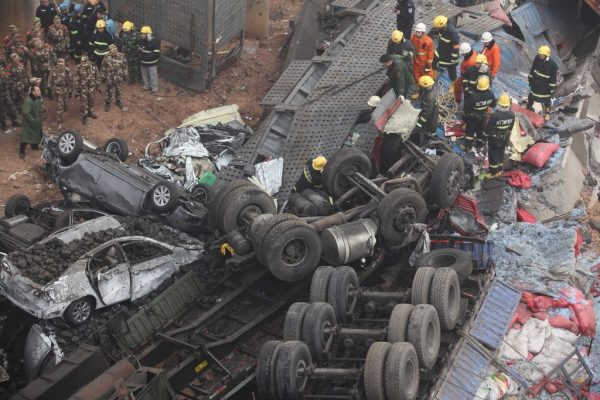 The wheels and axels of trucks and cars that had fallen from the Henan province Lianhuo Highway Yichang Bridge collapse.