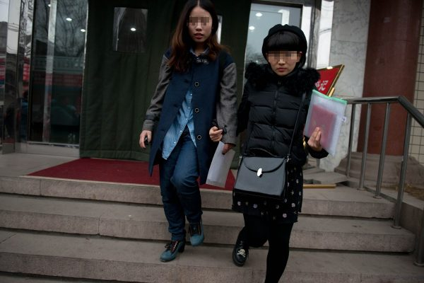Elsie and Mayu are walking out of Dongcheng District Social Service Center .