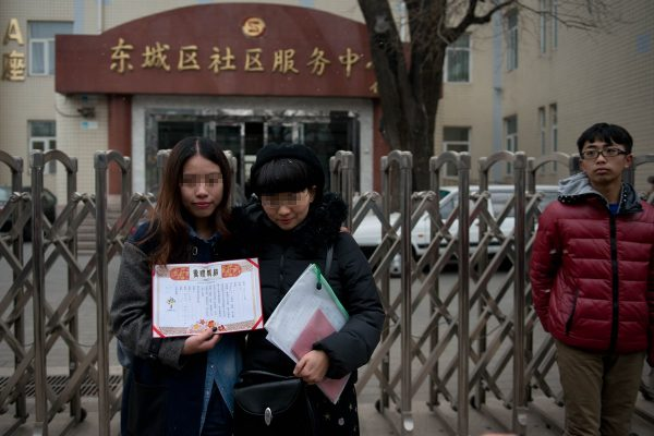 Elsie and Mayu are standing outside the Dongcheng District Social Service Center.