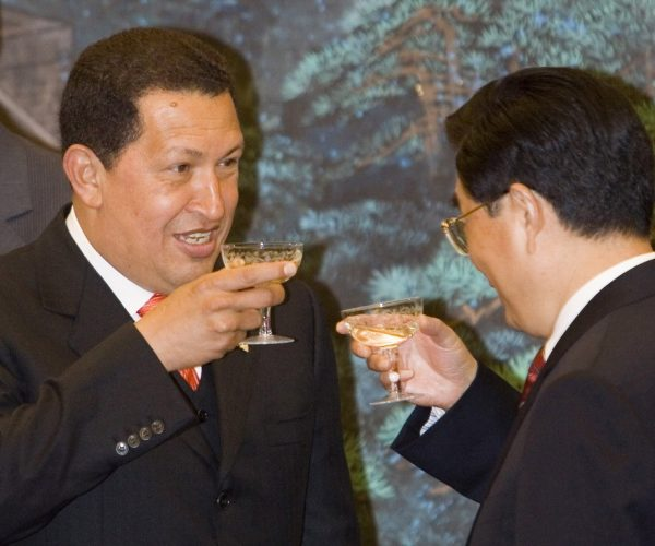 2006 August 24, Great Hall of the People, Beijing: At a signing ceremony, Venezuelan President Chávez (left) and Chinese President Hu Jintao drink a toast.