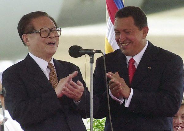 2001 April 15, Simón Bolívar International Airport, Venezuela: Chinese President Jiang Zemin (left) attends a welcoming ceremony held by Venezuelan President Chávez.