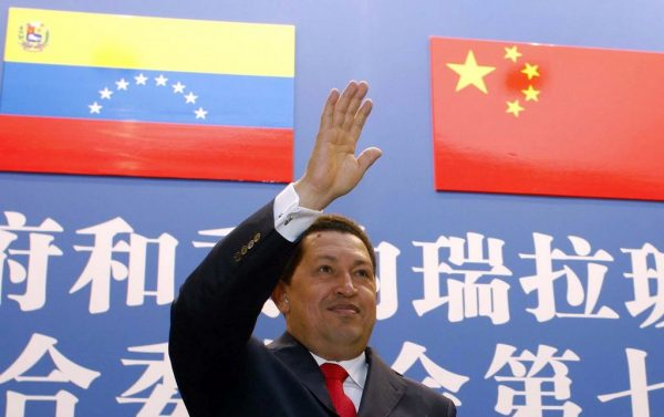 2008 September 24, Beijing: During a high-level Chinese-Venezuelan committee meeting, Venezuelan President Hugo Chávez holds his hand out in a gesture of greeting.