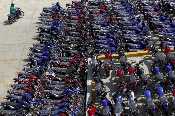 "2011 December 14, Caracas, Venezuela: Imported motorcycles from China parked outside the Keeway factory. At that time, China approved trading for petroleum through ""gear loans"" in Venezuela."