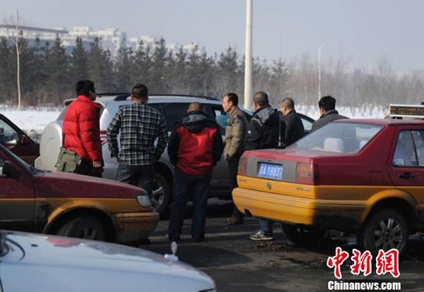 Taxis gathered to help search for an infant boy accidentally abducted in the back seat of a stolen car.