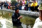 """China, Yunnan province, Zhaotong city, a blind beggar was beat up and then thrown into a pond by """"chengguan"""" city management officials who have since been suspended by the city government."""