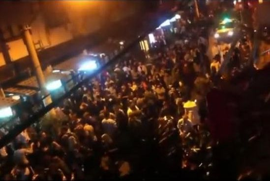 A Crowd of Foreigners Gathered at the Bar Street of Shanghai Late at Night.