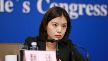 A pretty Chinese female interpreter, translator at the NPC Press Center.