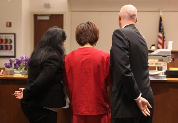 Xu Yichun with interpreter and attorney Scott Leist in court.