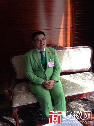 Sensationalistic Chinese philanthropist Chen Guangbiao in a green suit.