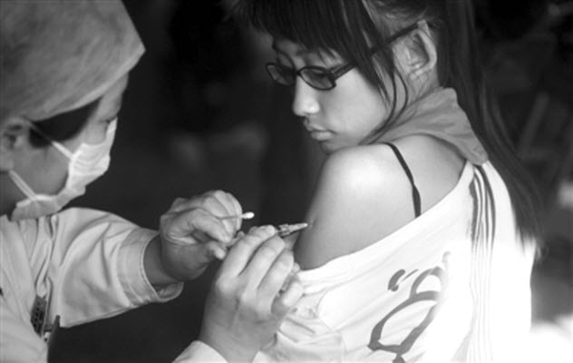 Chinese girl receiving vaccination shot.