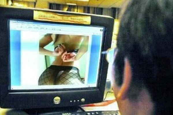 A Chinese man looking at pornographic content on the internet.