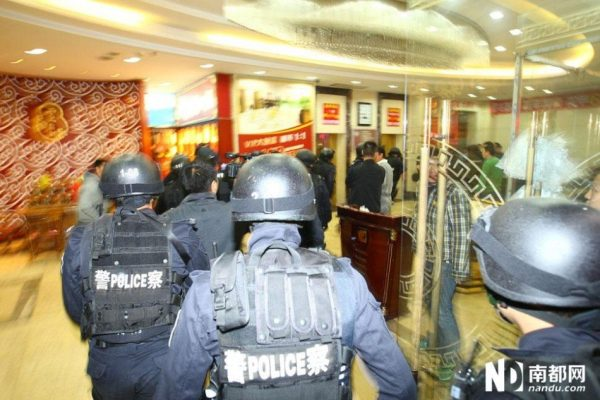 The police are entering the restaurant.