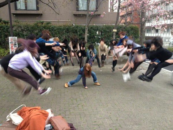 Japanese youth performing energy wave attacks (makankosappo kamehameha hadouken fireball).