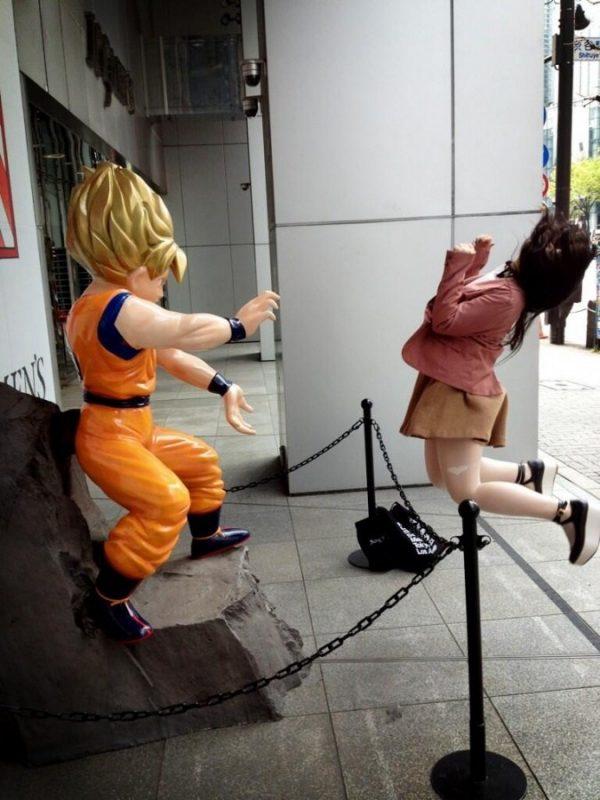 Japanese girl struck by Goku's kamehameha energy attack.