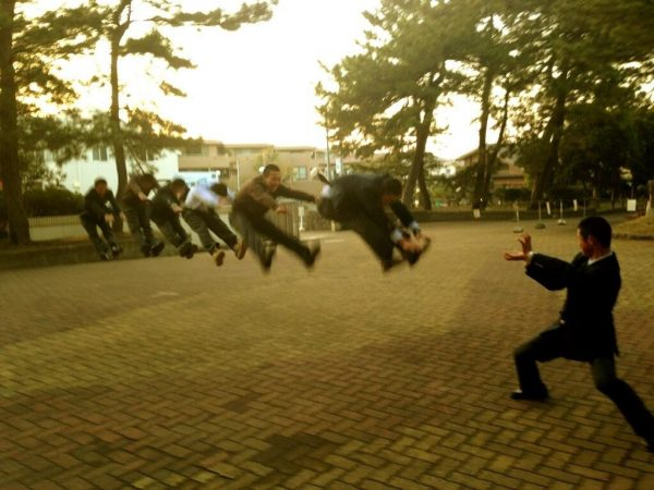 Japanese schoolboys performing energy wave attacks (makankosappo kamehameha hadouken fireball).