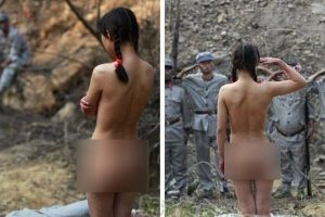 "A naked Chinese girl salutes Red Army soldiers in a Chinese television series set during the historical ""War of Resistance Against Japan"" time period."