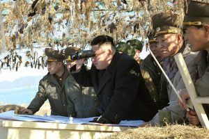 North Korean Supreme Leader Kim Jong-un inspecting the front lines with military personnel.