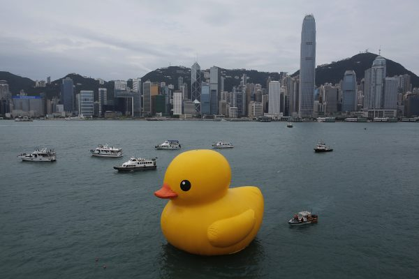A 16.5-meter-high giant Rubber Duck by Dutch artist Florentijn Hofman is towed along Hong Kong's Victoria Habour Thursday, May 2, 2013. Since 2007 the Rubber Duck has traveled to veries cites including Osaka, Sydney, Sao Paulo and Amsterdam. (AP Photo/Vincent Yu)