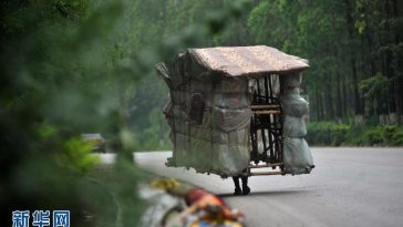 "Liu Lingchao, a Chinese man from Guangxi who has spent the past 5 years walking across the country on a journey back to his hometown carrying a portable ""house"" (makeshift shelter) on his shoulders, collecting recyclable garbage to make a living."
