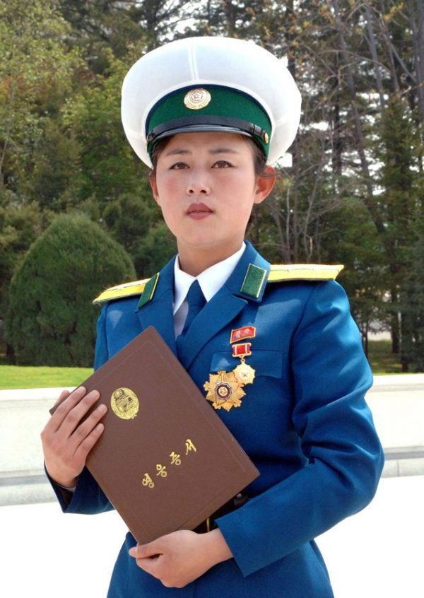 "Pyongyang, North Korea, female traffic officer Ri Kyong Sim awarded the rare ""Hero of the Republic"" honor for protecting a senior government official."