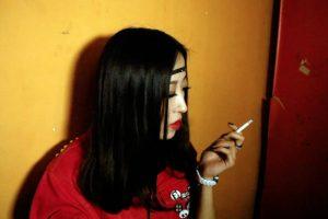 Chinese girl smoking cigarette.